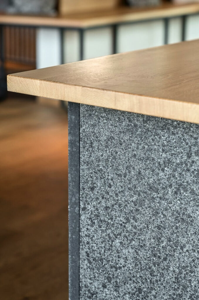 the strong materiality of the stone bar provides identity