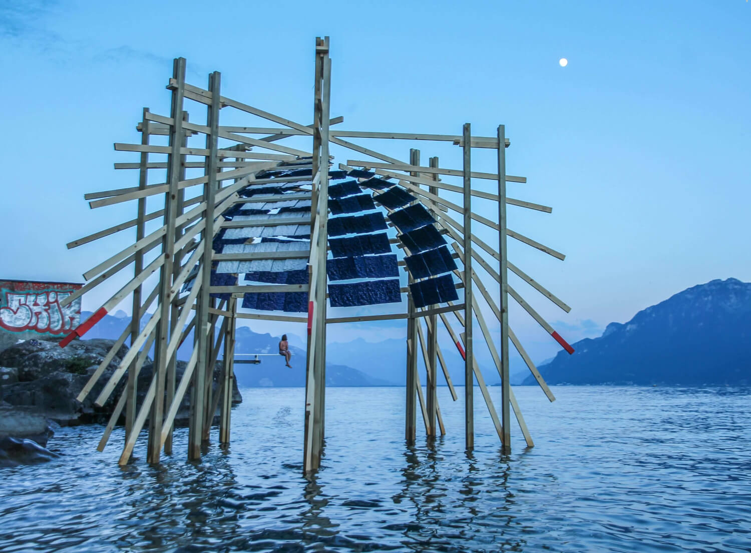 the architecture installation is a pavilion which is constructed in the water