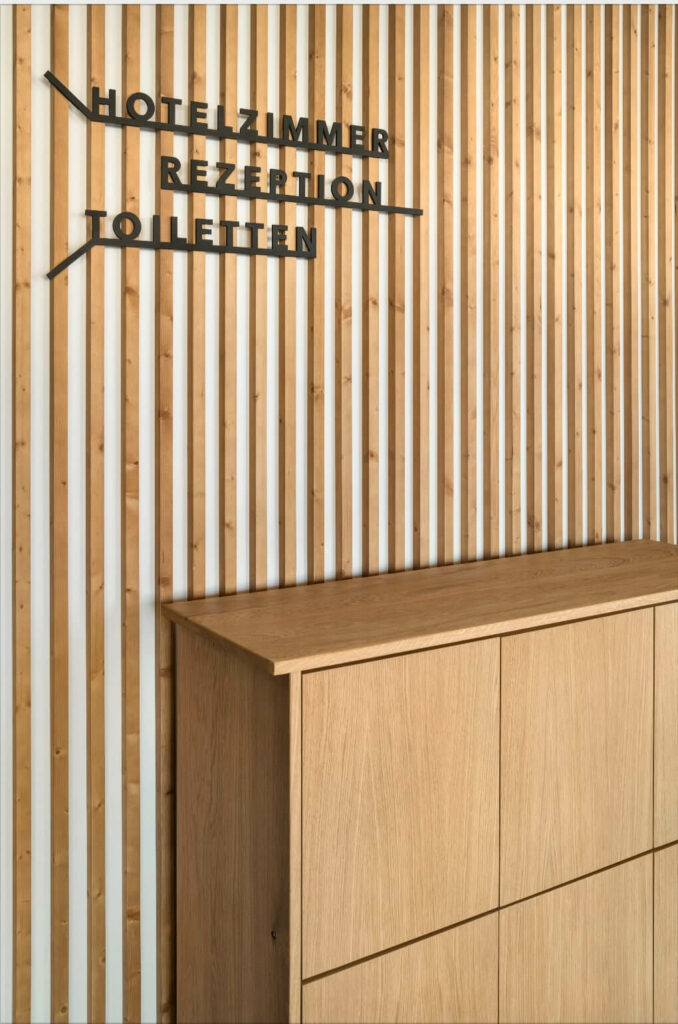 the custom-made oak cabinet is designed for a hotel lobby