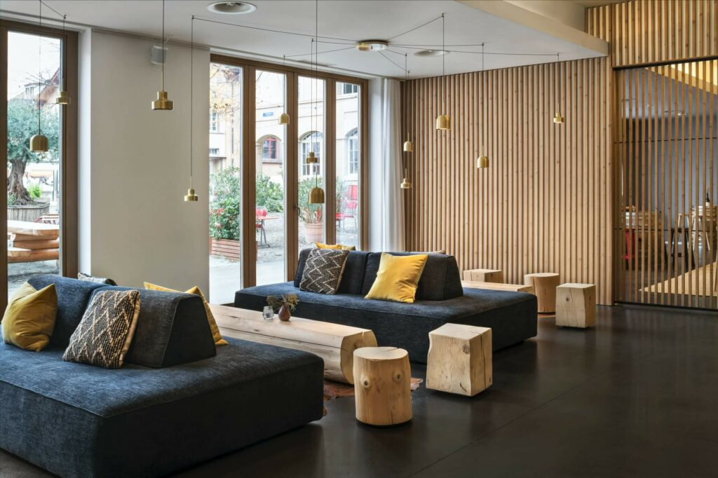 the lobby of the hotel has a nordic design which integrates wood