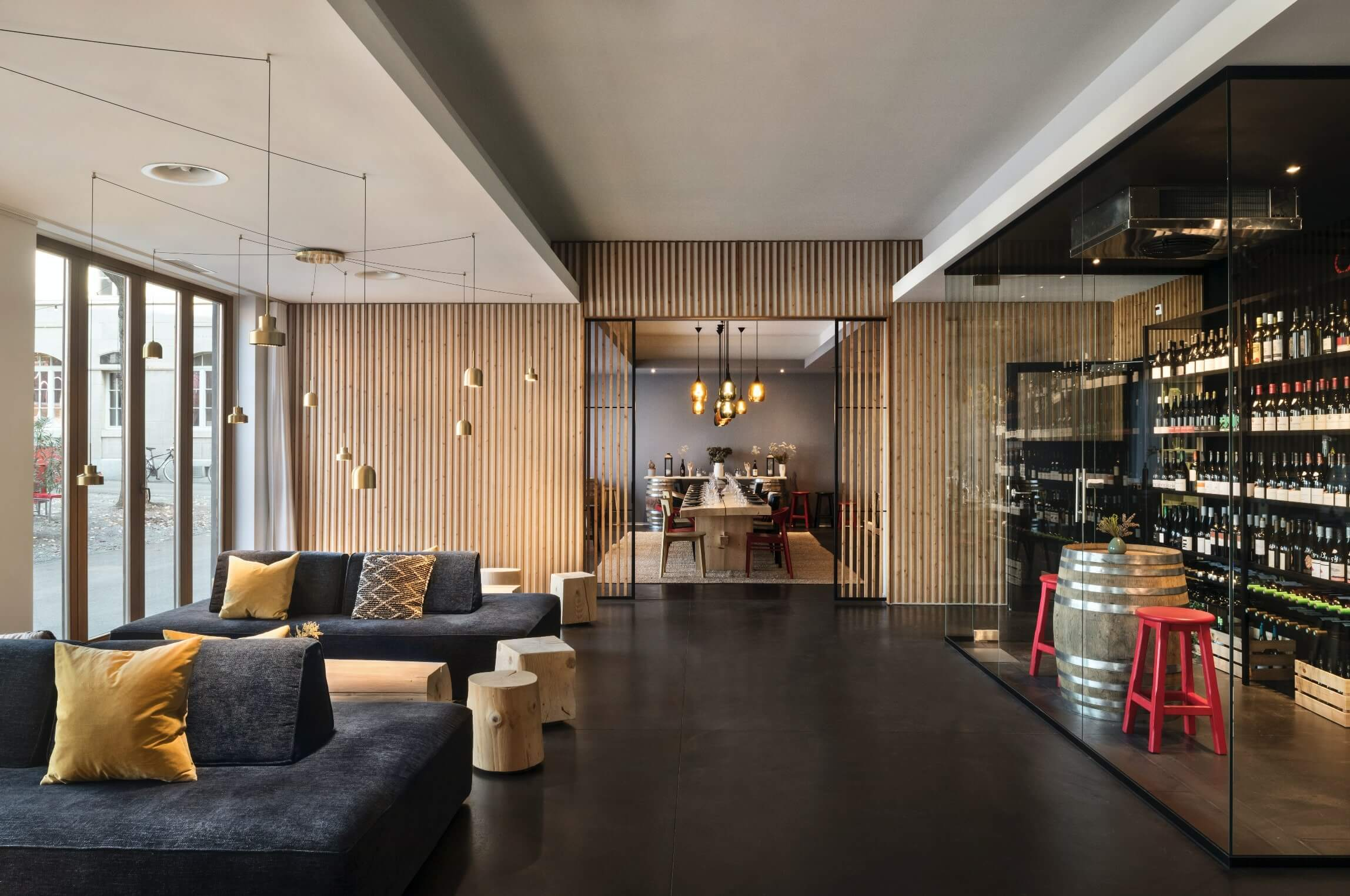 the design of the lobby in the hotel integrates the carnozet and a wood wall