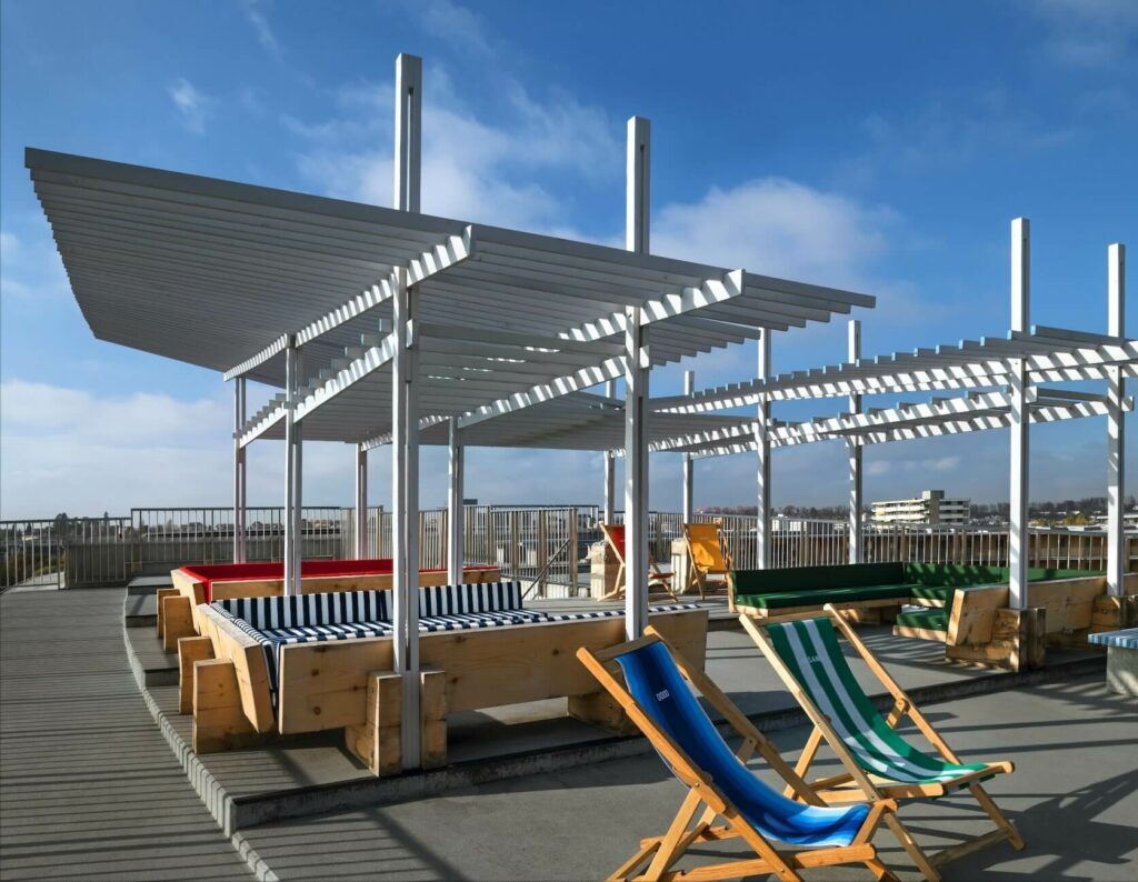 the design of the pergola has a structure which looks like a flying bird