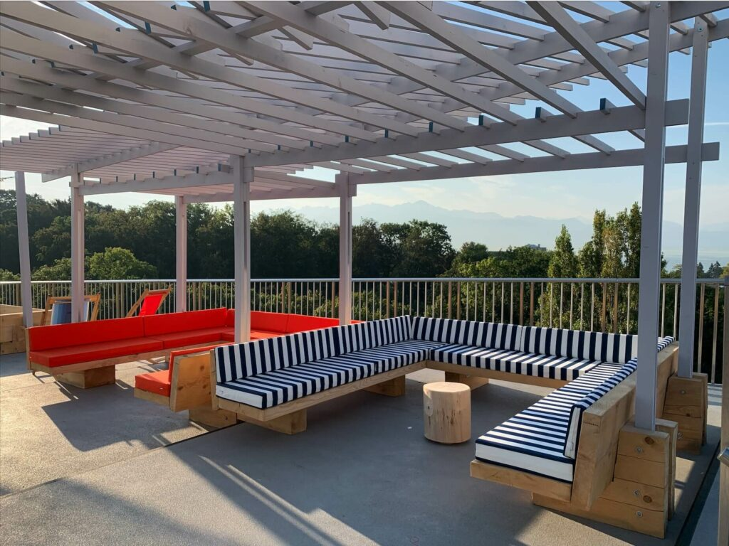 the woodden structure of the pergola has an architecture design