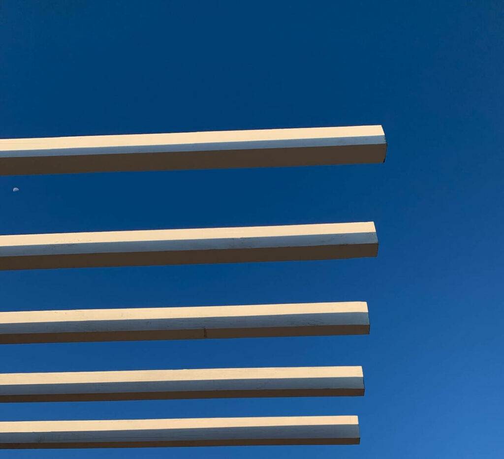 the architecture detail of the lumber used for the pergola in the sky